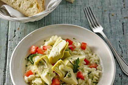 Rezeptbild zum Rezept Gemüse-Risotto mit Artischockenherzen, Tomaten und Rucola