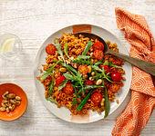 Mediterraner Reis mit Rucola und Tomaten